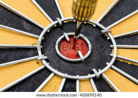 Closeup dart target with arrow hitting on bullseye in dartboard, Marketing  business concept, abstract background - stock photo