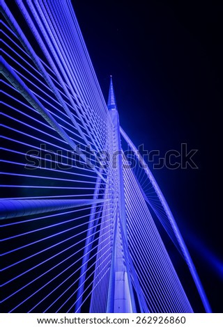 Closeup design of Sri Wawasan bridge at Putrajaya, Malaysia.  A night view showing color lighting on the steel structure. - stock photo