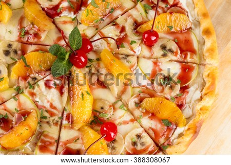 closeup dessert food the sweet pizza with orange, banana, apple and cherry