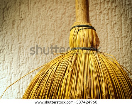 Closeup detail of a broom.