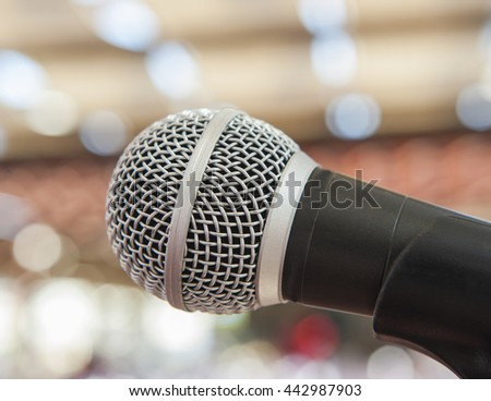 Closeup detail of a microphone on a stand at a live performance