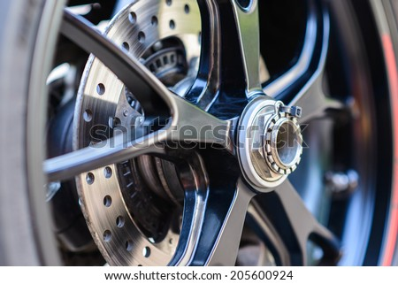 Closeup detail of a motorcycle's rear wheel - stock photo