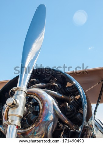 Closeup Detail of a Propeller Aircraft's Prop and Engine - stock photo