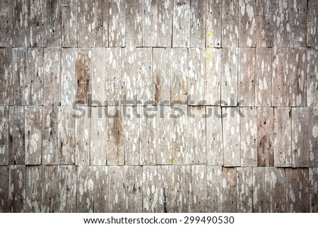 closeup detail of abstract sepia grunge wood shingle wall pattern background - stock photo