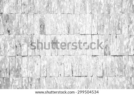 closeup detail of abstract white grunge wood shingle wall pattern background - stock photo
