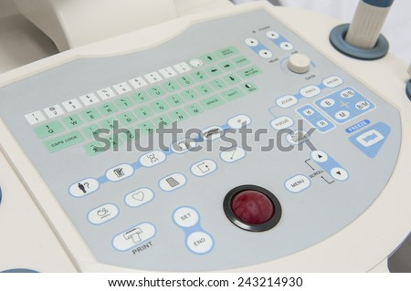 Closeup detail of an ultrasound scanner machine control keypad in medical center hospital - stock photo