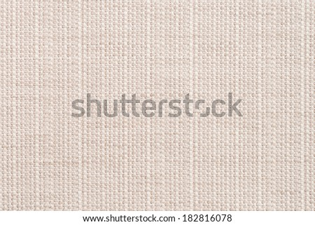 Closeup detail of beige fabric texture background. - stock photo