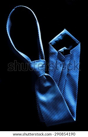 Closeup detail of blue tie for dressing up with suit and white shirt - stock photo