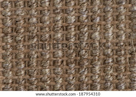 Closeup detail of brown carpet texture background. - stock photo