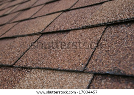 closeup detail of brown roof shingles - stock photo