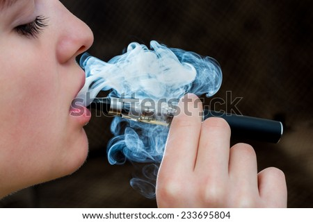 Closeup detail of Female with an Electronic Cigarette, Horizontal shot
