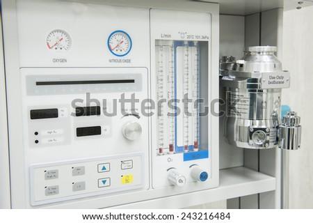 Closeup detail of flowmeter gauge on medical hi-tech anesthetic machine in health care center hospital - stock photo