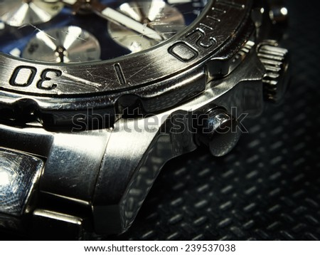 Closeup detail of used and scratched wristwatch. - stock photo