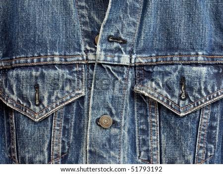closeup detail of vintage denim jacket - stock photo