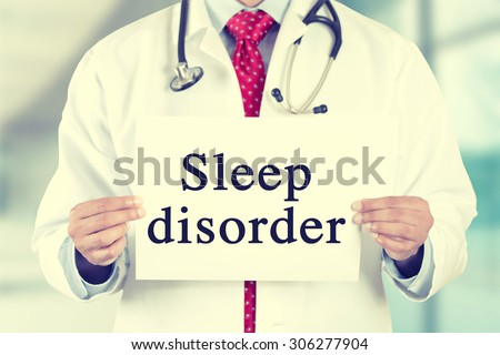 Closeup doctor hands holding white card sign with sleep disorder text message isolated on hospital clinic office background. Retro instagram style filter image - stock photo
