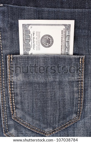 closeup 100 dollars in a jeans pocket - stock photo