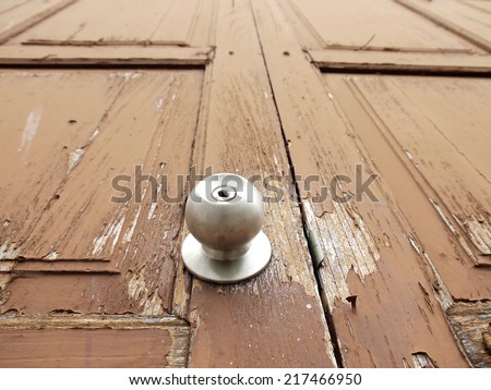 closeup Doorknob on wood brown door - stock photo