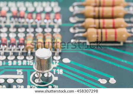 Closeup electronic hardware . Resistor and condensers assembly on the circuit board - stock photo