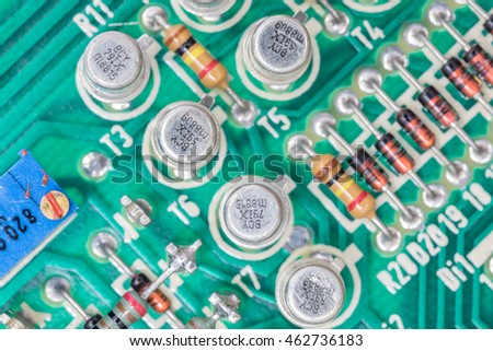 Closeup electronic hardware .Resistor and condensers assembly on the circuit board