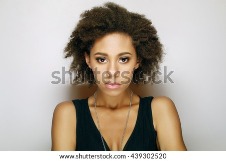 closeup emotional portrait of a beautiful young african woman - stock photo