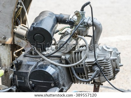 closeup engine of matorcycle on the road - stock photo