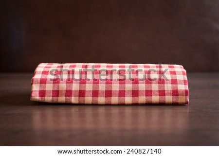 Closeup fabric on wooden table - stock photo