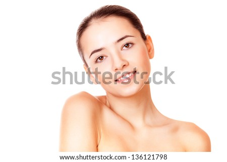 closeup face beautiful woman with healthy clean skin looking at camera - stock photo