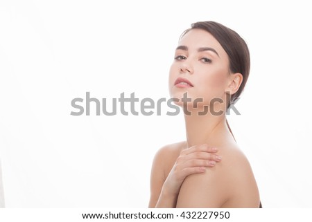 Closeup face beautiful woman with healthy clean skin looking at camera over white background. Studio shot. - stock photo