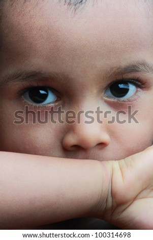 Closeup face of a sharp looking little girl - stock photo