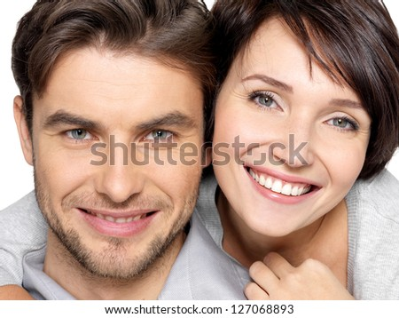 Closeup face of  beautiful happy couple isolated on white background. Attractive man and woman being playful.