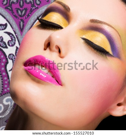 Closeup face of beautiful woman with fashion bright  makeup - stock photo