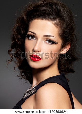 Closeup face of brunette woman with fashion makeup and red lips - stock photo