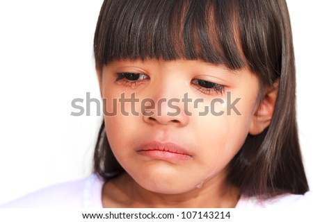 Closeup face of little girl crying with tears rolling down her cheeks - stock photo