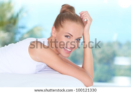 Closeup facial expression of a beautiful high-spirited woman laughing into the camera - stock photo