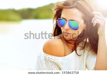Closeup fashion beautiful woman portrait wearing sunglasses - stock photo