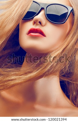 closeup fashion beautiful woman portrait with long hair wearing sunglasses - stock photo