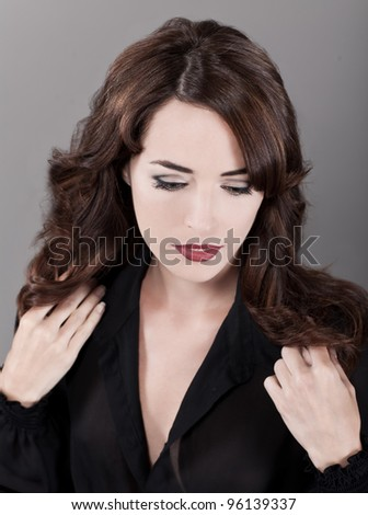 Closeup fashion portrait of sensuous woman isolated on gray background