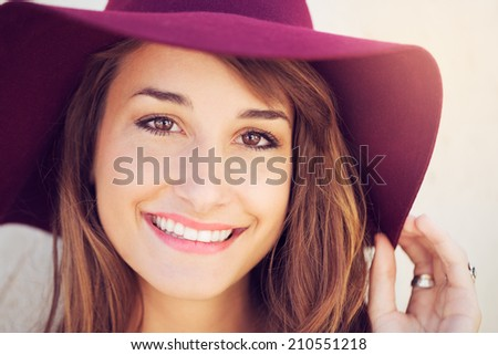 Closeup fashion portrait of young beautiful woman in hat - stock photo