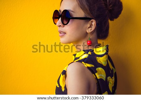closeup fashion portrait of young sexy funny crazy woman posing on Yellow wall background in summer style  - stock photo