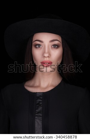 closeup fashion studio portrait of beautiful woman isolated over dark background