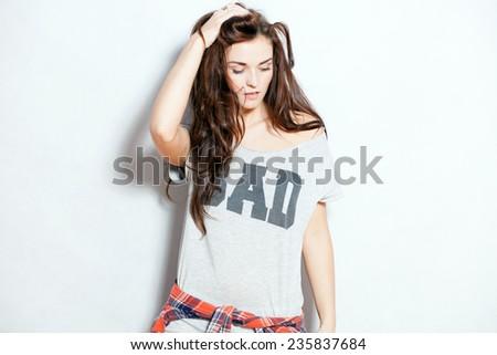 Closeup fashion studio portrait of hipster young woman - stock photo