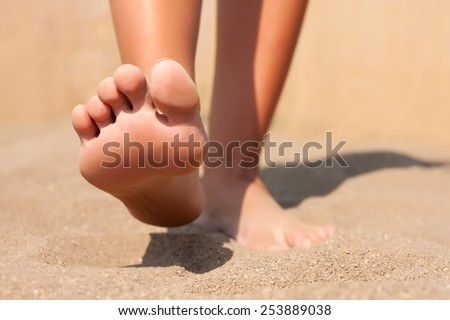 Closeup feet on beach summer - stock photo