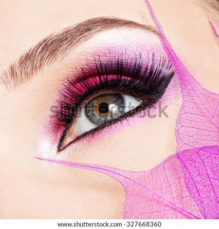 Closeup female eye with  beautiful fashion bright pink makeup  - stock photo