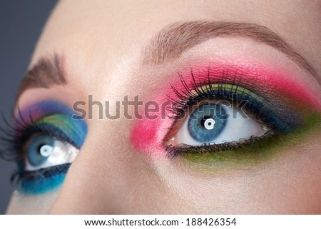 Closeup female eyes with beautiful fashion bright makeup
