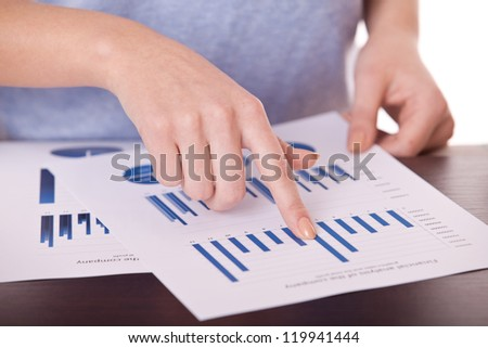 closeup female hands and business document with diagram - stock photo