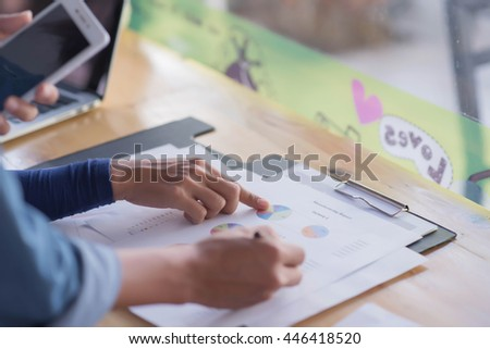 closeup female hands and business document with diagram