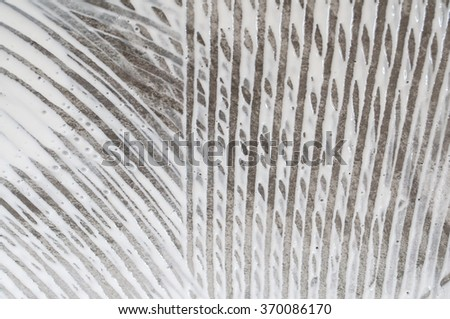 Closeup floor texture or abstract backgrounds. This texture of white adhesive latex on concrete floor created by worker's hand tool.  - stock photo