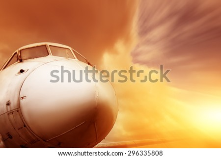 closeup flying airplane on sunset in motion. vintage picture - stock photo