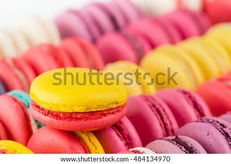 closeup French dessert macaroon on a background of colorful cakes