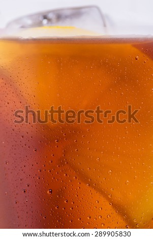 closeup from a cola glass with dew drops and ice cubes - stock photo